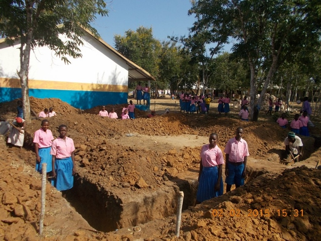 Children-in-footings-of-new-classroom-660x495 Planting trees counters climate change in coast