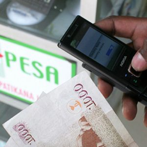 A M-PESA customer makes a transaction. Safaricom's deal with Travelport marks the second such in the last three months. www.businesstoday.co.ke