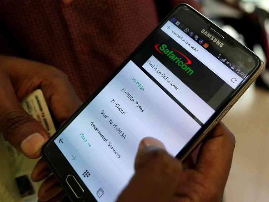 An M-Pesa user on their phone. Safaricom is seeking regulatory approvals for new wealth management products.