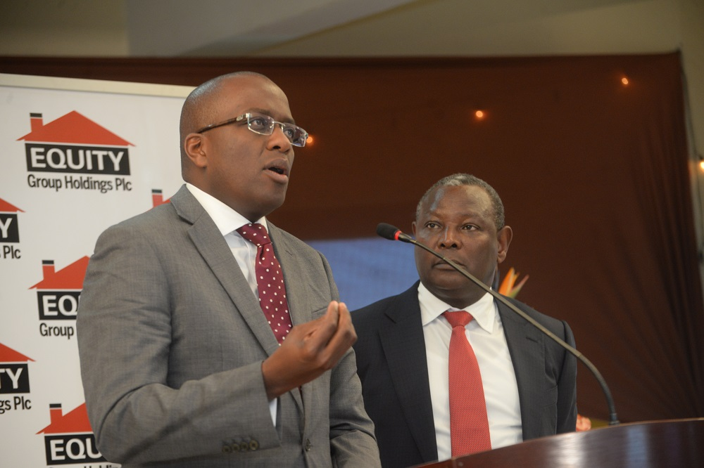Equity Bank Group Chief Commercial Officer Polycarp Igathe (left) makes remarks during the release of Equity Group Holdings Plc 2018 half-year financial results at Equity Centre as Group Managing Director and CEO Dr James Mwangi, looks on. PHOTO / BUSINES TODAY