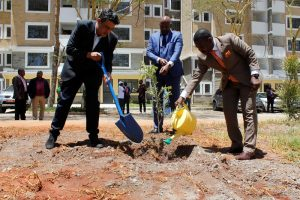 Karibu Homes Founder and Managing Director Mr. Ravi Kohli, Shelter Afrique Managing Director & CEO Andrew Chimphondah, and Shelter Afrique Chairman Daniel Nghidinua plant and water a tree to mark the launch of phase II of Karibu Homes. The housing project was funded by Shelter Afrique at a cost of Ksh 355 million. www.businesstoday.co.ke