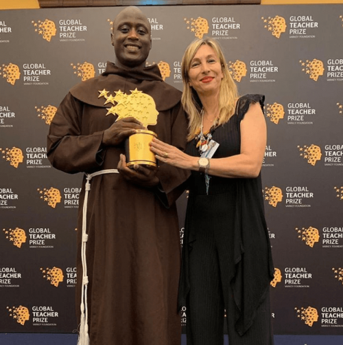 A Varkey foundation official poses for a photo with Kenyan teacher Peter Mokaya Tabichi, the winner of this year's Global Teacher Prize www.businesstoday.co.ke