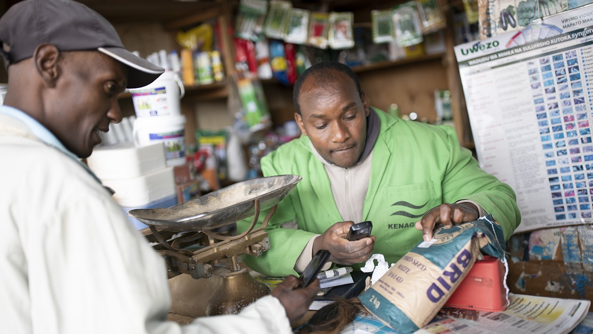 A farmer at an agro shop in Kenya verifies maize seeds before purchase.