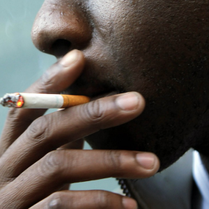 A man smoking cigarette www.businesstoday.co.ke