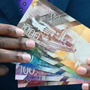 Central Bank of Kenya Governor Patrick Njoroge clutches the new currency notes. Businesses have set earlier deadlines for accepting old generation Ksh 1,000 notes. www.businesstoday.co.ke