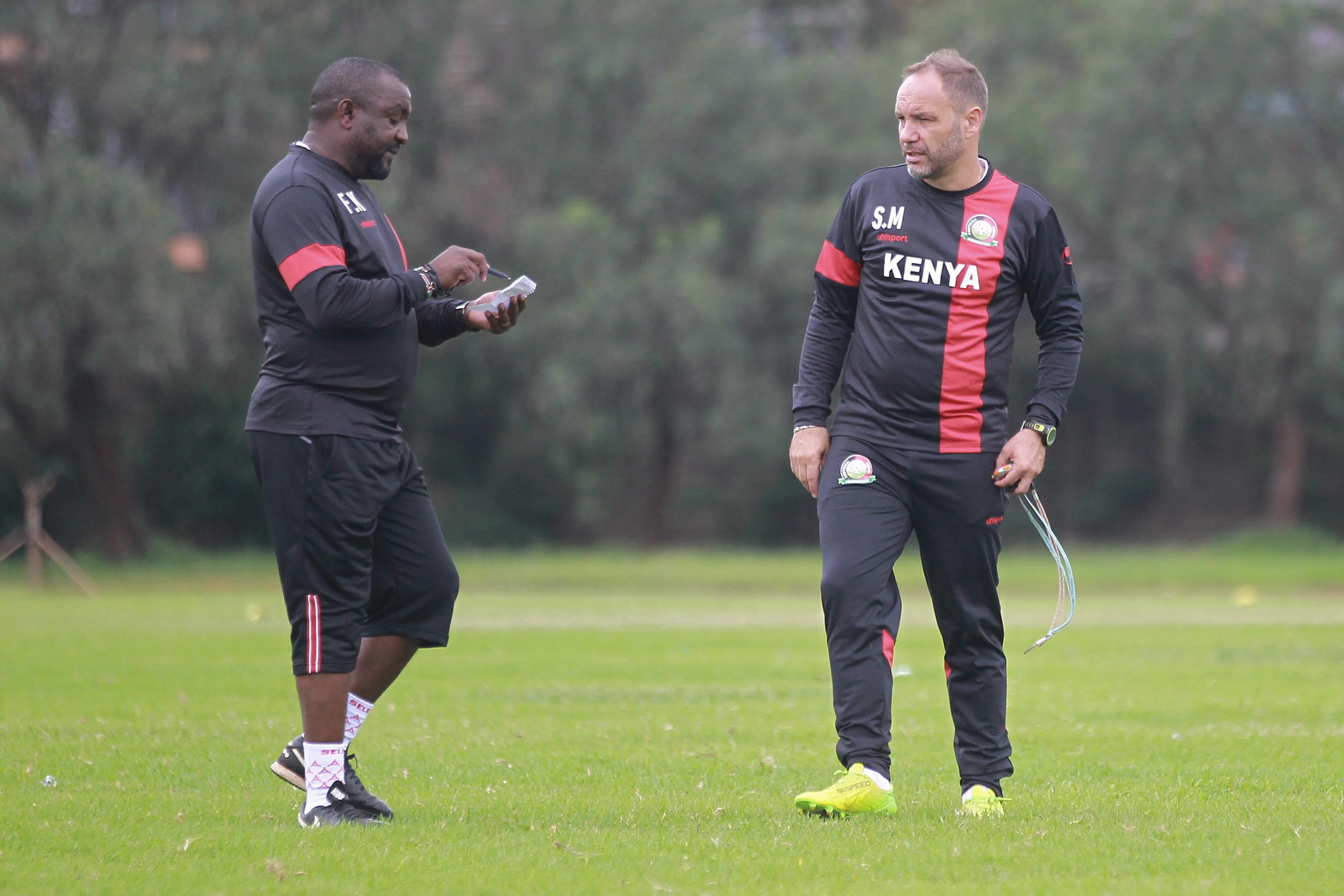 Francis Kimanzi (left) shares notes with Sebastien Migne during Harambee Stars' pre-AFCON training camp. Kimanzi has been appointed to replace Migne who was sacked on Monday. www.businesstoday.co.ke