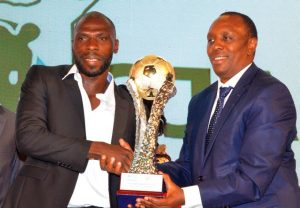 Gor Mahia and Harambee Stars defender Joash Onyango receives his award at the SJAK KPL Awards dinner. www.businesstoday.co.ke
