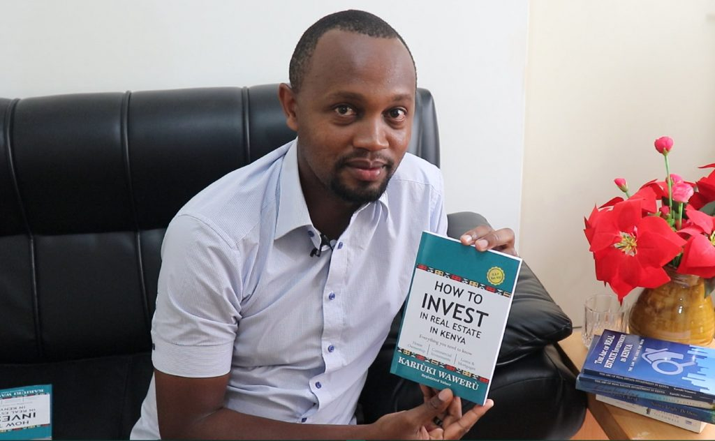 Kariuki Waweru poses with his book 'How to invest in real estate in Kenya. (Everything you need to know)'. He says that some areas in Kenya have already experienced a real estate bubble while others are thriving. www.businesstoday.co.ke