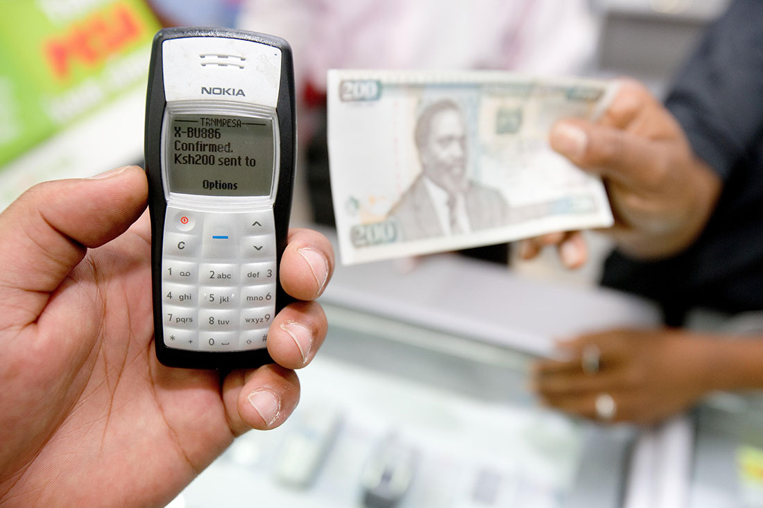 An M-Pesa transaction in progress. Super profits that Safaricom makes come from a majority of Kenyans who are either living under the poverty line or those slightly above it. www.businesstoday.co.ke