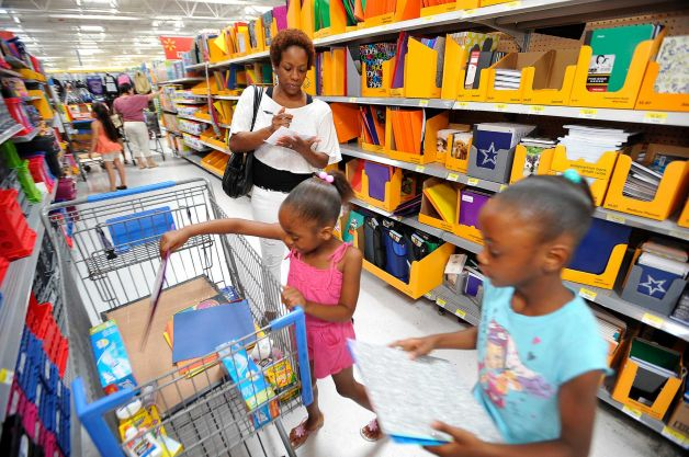 A mother shopping for school items with her daughters www.businesstoday.co.ke