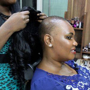 Wangui, a patient cancer trying on wig www.businesstoday.co.ke