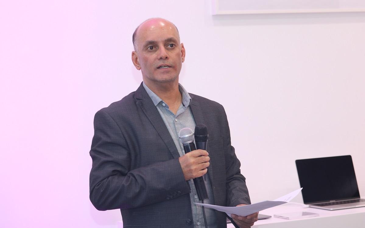Apple Kenya Personal Systems MD Mahmood Khambiye reads his speech at the Store launch www.businesstoday.co.ke