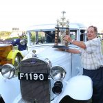 John Wroe Winner Cars Division at the CBA CONCOURS D'ELEGANCE poses with the number one trophy and his car at the CBA CONCOURS D'ELEGANCE held at the Ngong racecourse. www.businesstoday.co.ke