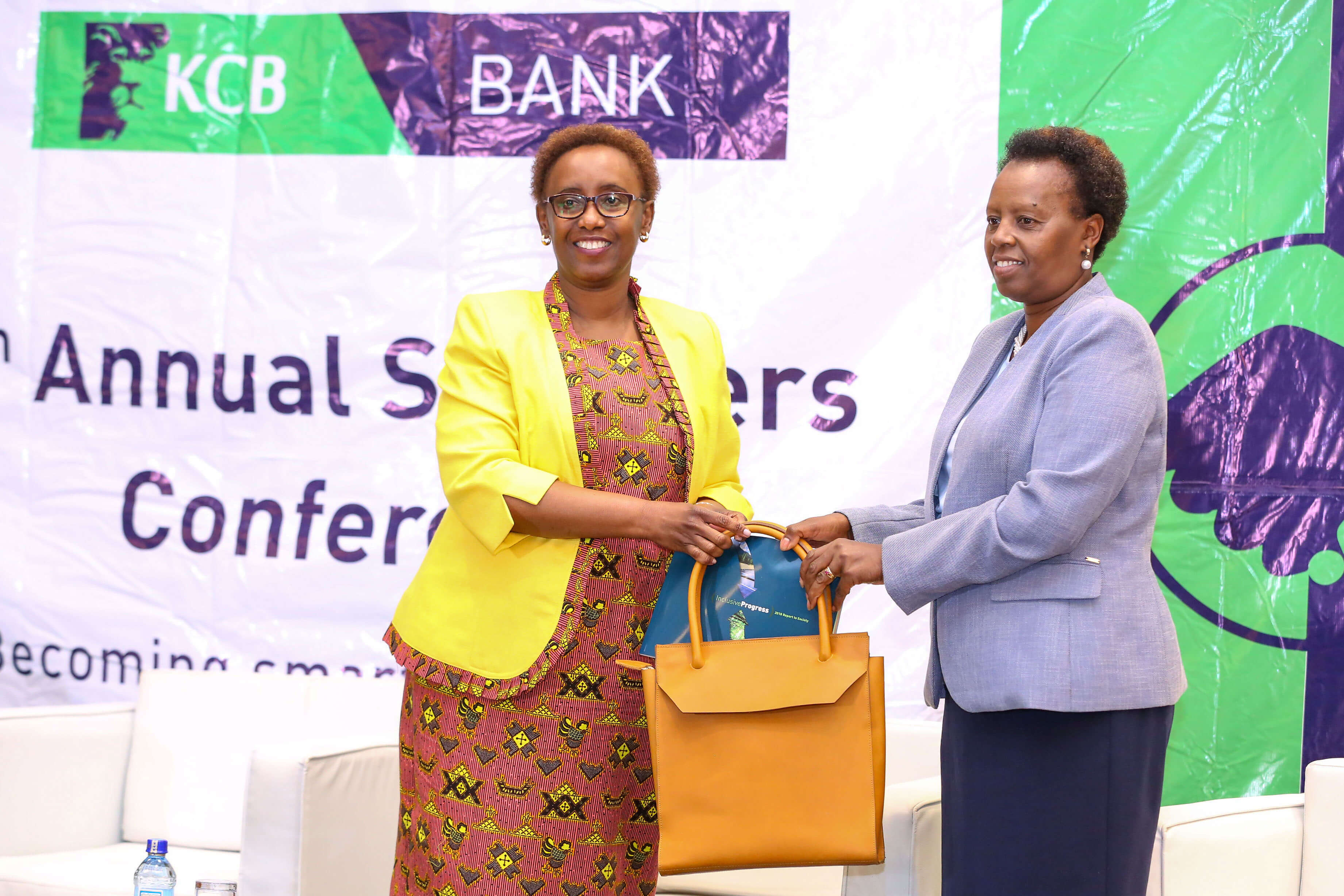 KCB Group Head of Corporate and Regulatory Affairs, Judith Sidi Odhiambo (L), presents a copy of the 2019 KCB Sustainability Report and token of appreciation to Kenya Breweries Limited Managing Director Jane Karuku during the 5th KCB Annual Supplier conference at a Nairobi hotel. www.businesstoday.co.ke