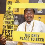 Celebrated Kenyan Kenyan hip hop artist, Juakali Pose with a Tusker Oktoba Fest Frame during the unveil the 2 days Festival held at the Blue Door Beer Garden. www.businesstoday.com