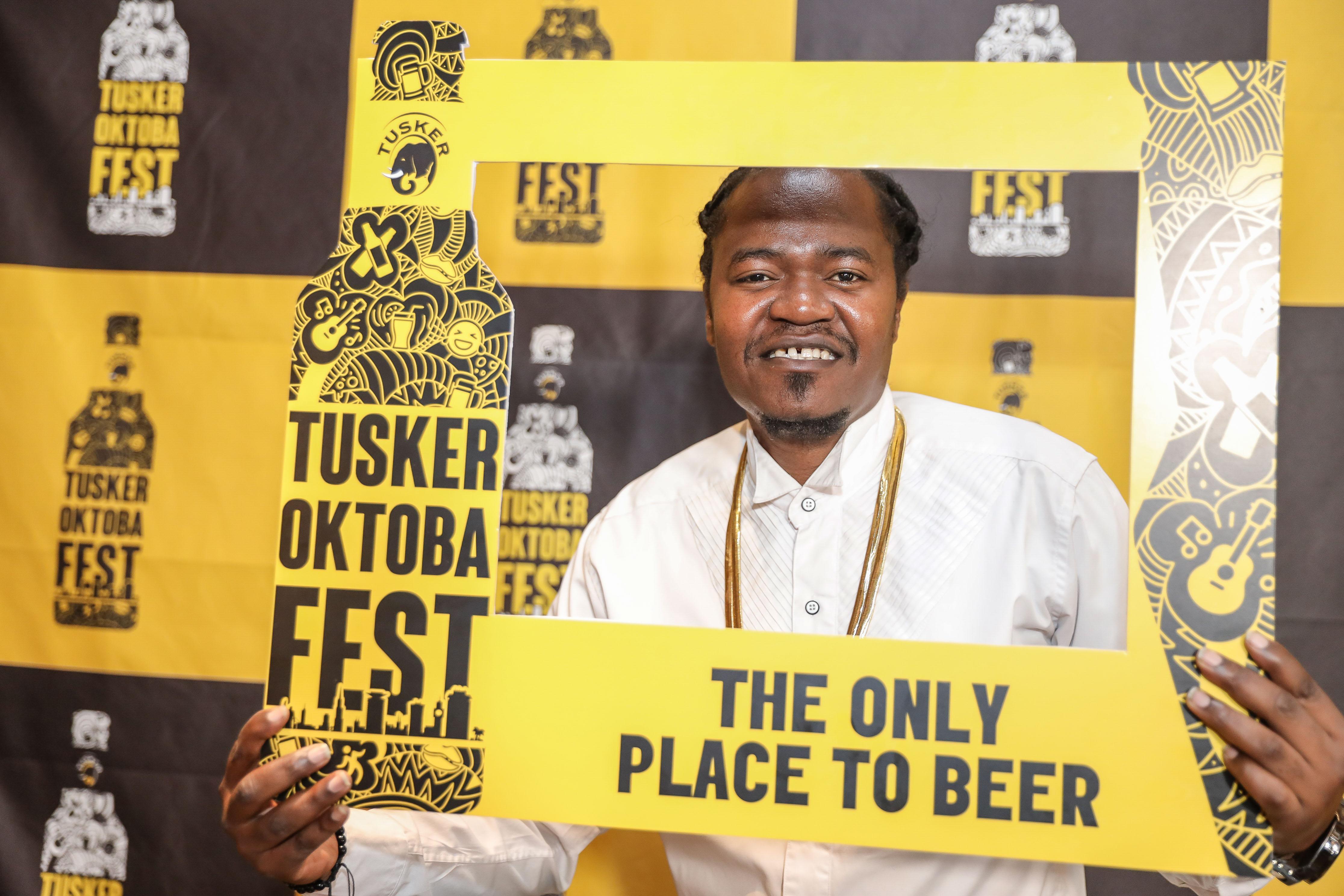 Celebrated Kenyan Kenyan hip hop artist, Juakali Pose with a Tusker Oktoba Fest Frame during the unveil the 2 days Festival held at the Blue Door Beer Garden. www.businesstoday.com