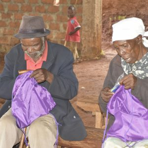 Elderly locals looking into goodies bags in Nyamarambe www.businesstoday.co.ke