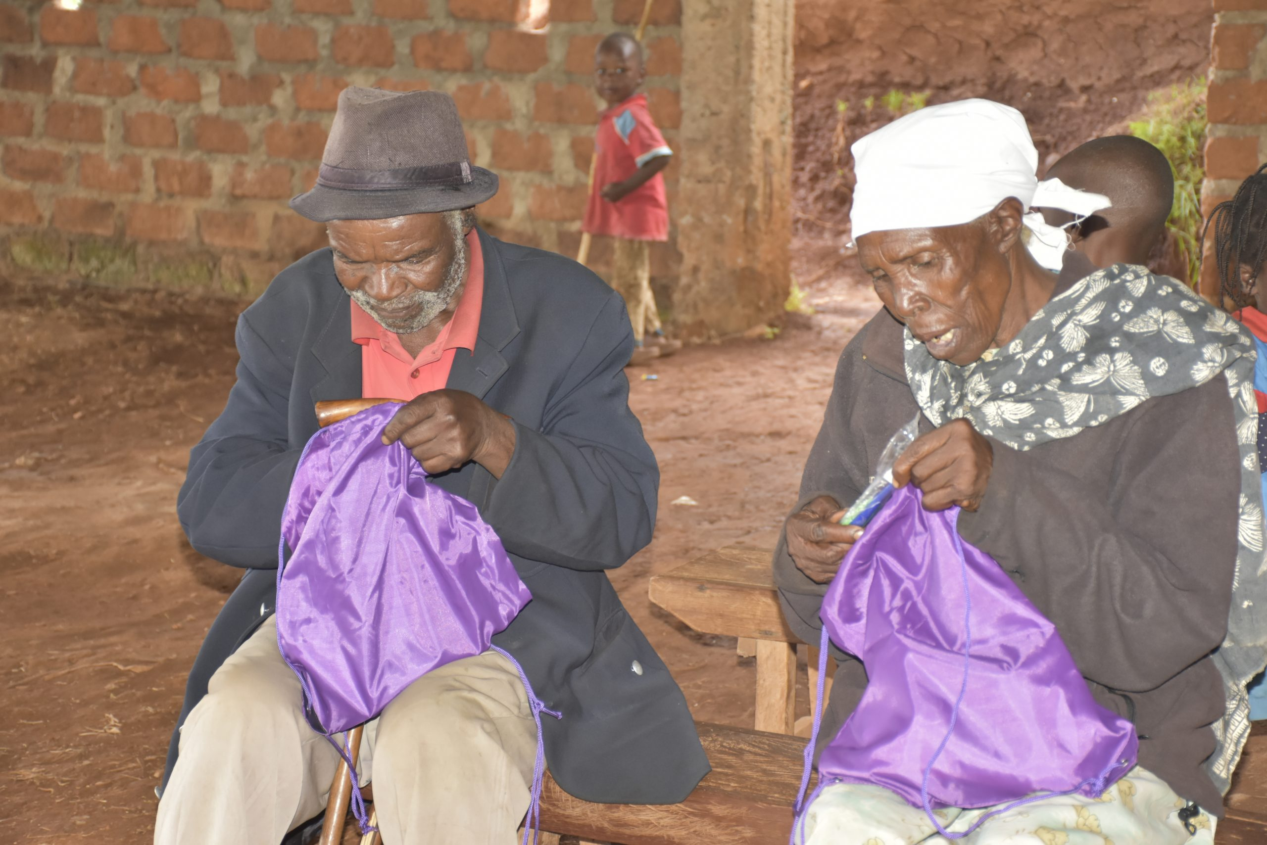 Elderly locals looking into goodies bags in Nyamarambe www.businesstoday.co.ke