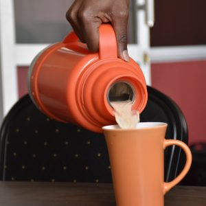Tea being poured into a mug www.businesstoday.co.ke