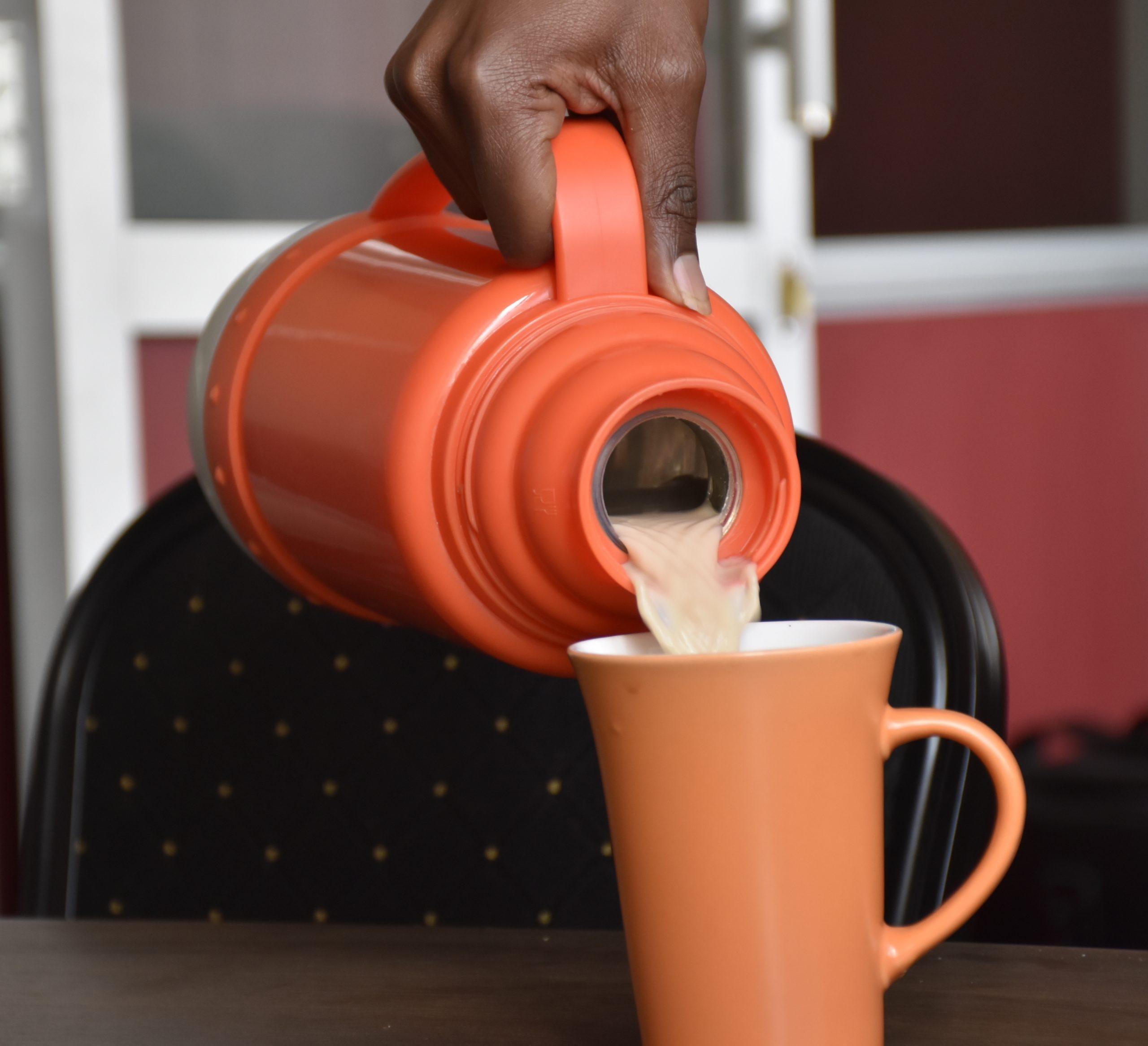 Tea being poured into a mug www.businesstoday.co.ke
