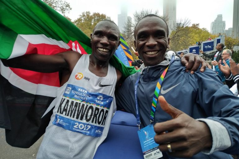 Eliud Kipchoge (right) poses for a photo with Geoffrey Kamworor after the 2017 Newyork marathon. www.businesstoday.co.ke