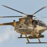 Afghan Air Force MD-530F Cayuse Warrior helicopter fires its two FN M3P .50 Cal machine guns during a media demonstration, April 9, 2015, at a training range outside of Kabul, Afghanistan. www.businesstoday.co.ke
