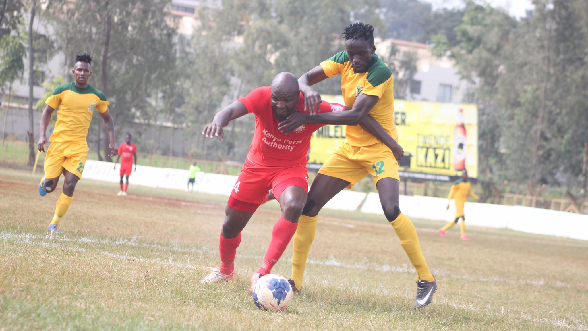 Mathare United players (in yellow) donned jerseys without the OdiBets logo during their league opener on Saturday. They drew 0-0 with Bandari. www.businesstoday.co.ke