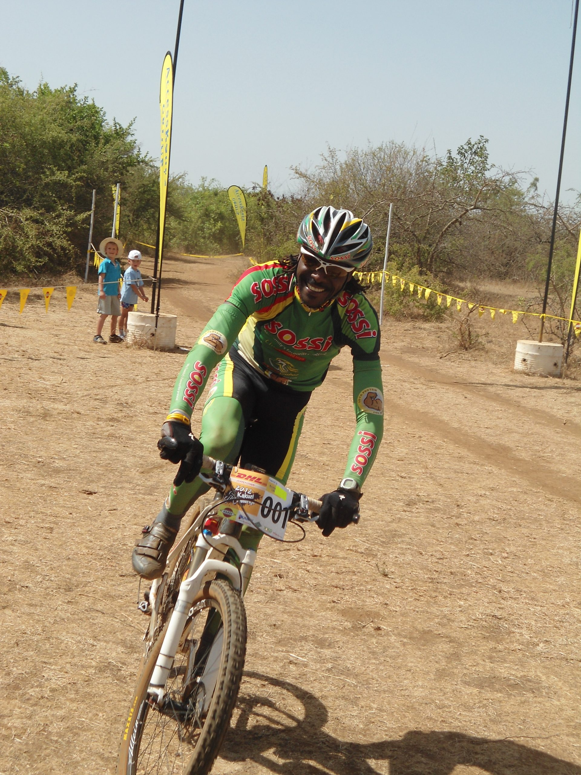 David Kinja participating in a cycling race www.businesstoday.co.ke