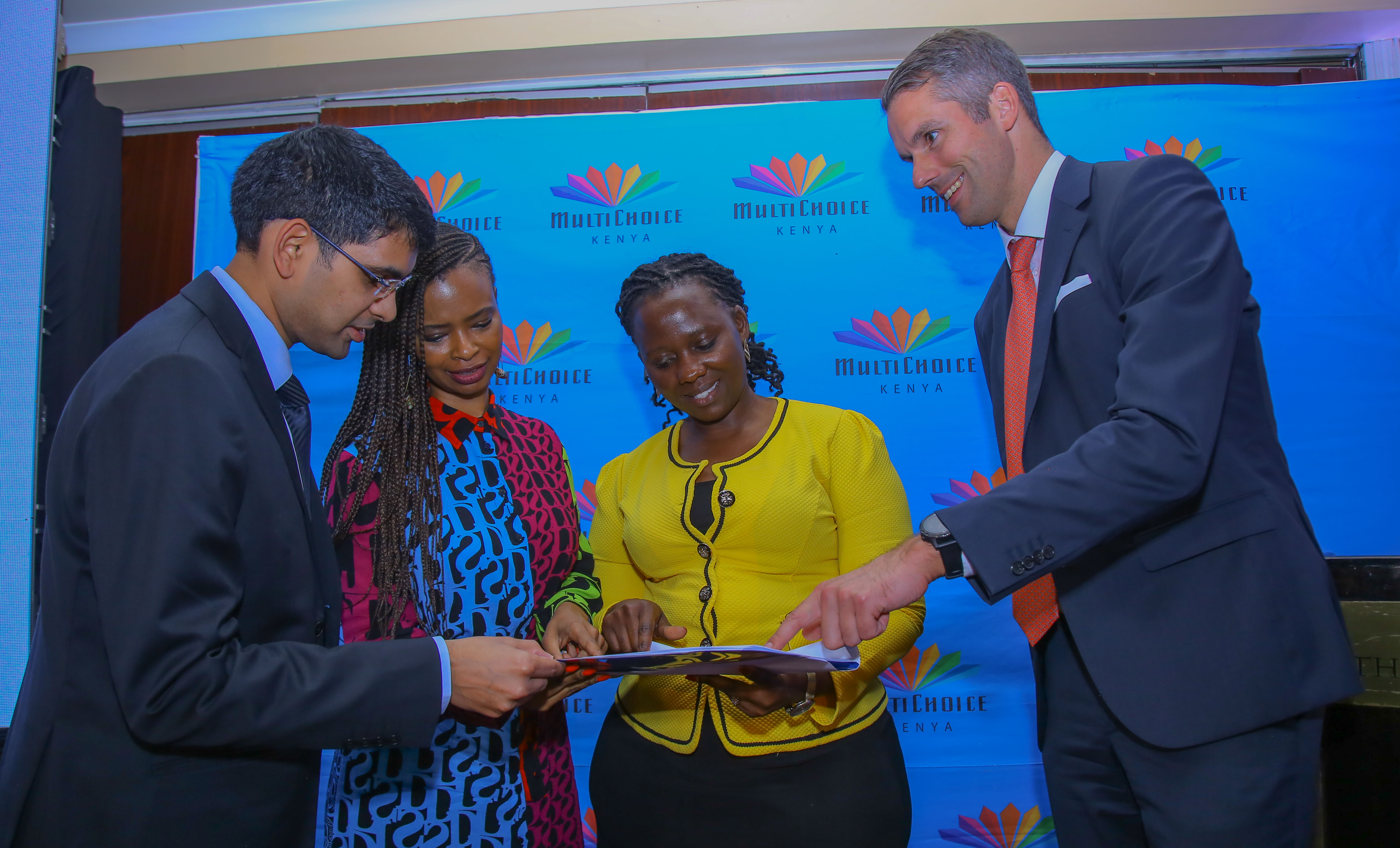 Vaibhav Rathi, Accenture Strategy Business Strategy Manager; Reatile Tekateka, MultiChoice Group Executive Head of Corporate Affairs; Ruth Omondi, Ag. Finance Manager MultiChoice Kenya and Wolfgang Popp, Accenture Strategy Principal Director at the launch of MultiChoice Kenya's socio-economic impact report on 24 October 2019. www.businesstoday.co.ke