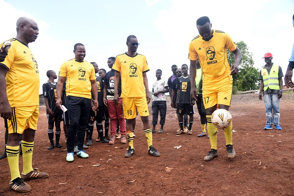 Former Harambee Stars midfielder and Kibra by election aspirant MacDonald Mariga tries to dribble the ball at the Woodley playground when he launched his election manifesto. www.businesstoday.co.ke