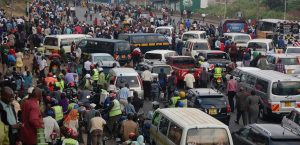 Matatus and boda boda riders at a busy terminus. 29 companies have been licensed to provide a cashless payment platform.