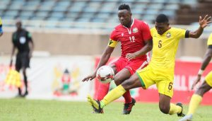 Harambee Stars' Victor Wanyama (left) tussles for the ball with Manuel Kambala of Mozambique during Sunday's International friendly. Harambee Stars lost the match 1-0. www.businesstoday.co.ke