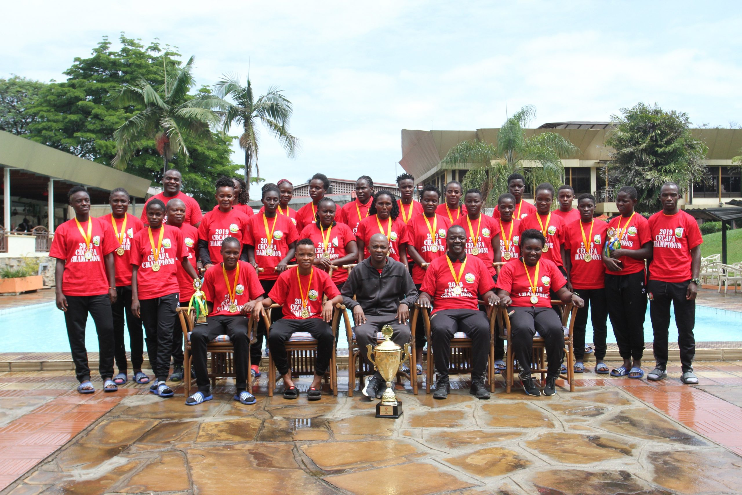 FKF President Nick Mwendwa with the Harambee Starlets squad pose for a picture with the trophy. www.businesstoday.co.ke