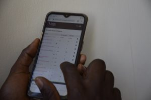 A mobile phone user. Kenyans are choosing mobile phone operators based on Internet Costs, Speeds as they seek value for money. www.businesstoday.co.ke