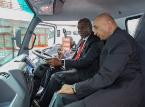 Kennedy Nyakomitta (Left), GM Asset Finance DTB and Mehul Sachdev, Senior Brand Manager Fuso, inside of a Fuso truck after the DTB and Simba Corp partnership signing at Simba Corp offices www.businesstoday.co.ke