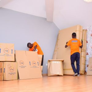 House movers packing household items. It is important to consider key factors before moving house. www.businesstoday.co.ke