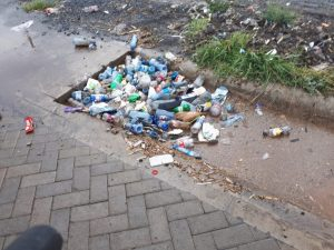 Plastic waste blocking a drainage system. The plastics value chain can create jobs through a circular economy approach. www.businesstoday.co.ke