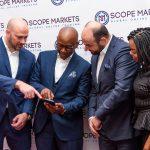 Scope Markets Kenya CEO Kevin Ng'anga demonstrates the platform to Serkan Ismailoglu as Dianah Igati and Jacob Plattner look on. www.businesstoday.co.ke