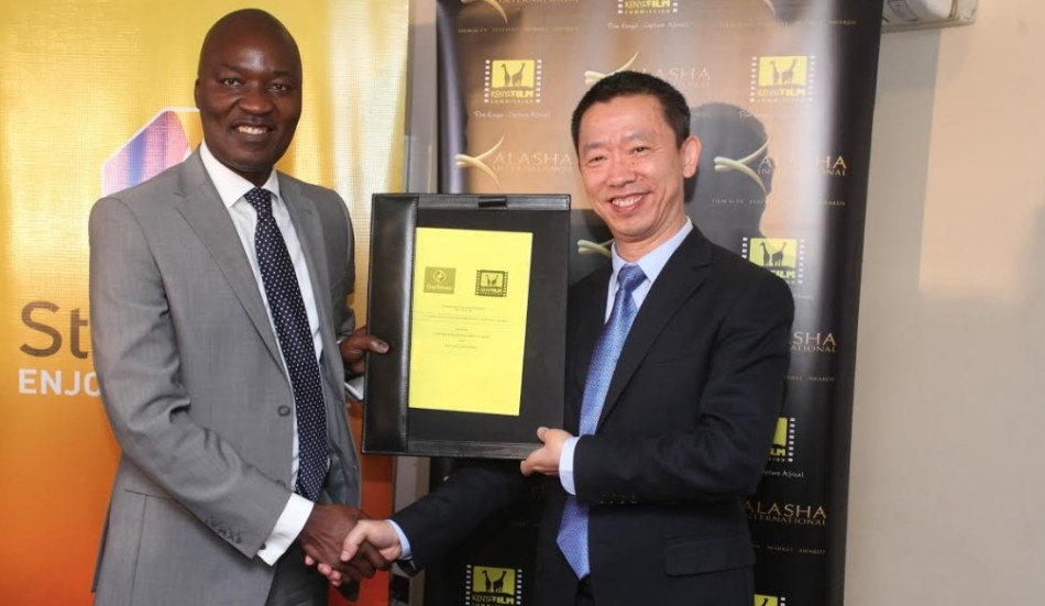 Kenya Film Commission CEO Timothy Owase (left) with StarTimes Kenya CEO Andy Wang. Kenyans now have to download the StarTimes app before voting for the Kalasha awards. www.businesstoday.co.ke