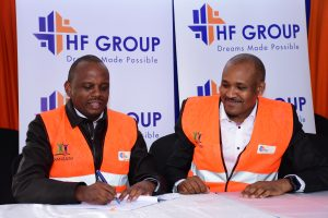 HF Group CEO Robert Kibaara (right) and Tecnofin Kenya Limited Executive Director, Robert Muchoki (left), sign a Memorandum of Understanding that will see HF Group provide end user financing and sales and marketing of 1,562 affordable housing units under development in Pangani, Nairobi. www.businesstoday.co.ke