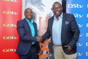 Danny Muchira, MD Trace East Africa shakes hands with Simon Kariithi Commercial GM Multichoice Kenya after the announcement on the launch of Trace Gospel. www.businesstoday.co.ke