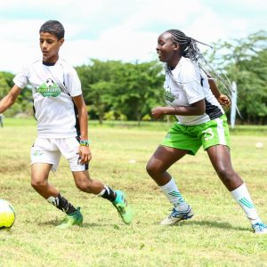 14- year- old, Swaleh Fahim, from Bahwan Muslim school (Mombasa) tackles 16- year- old, Lian Kimashia, from Maina Wanjigi Secondary School (Eastleigh) during the Dream Football Boot Camp at Ol-Donyo-Sapuk Resort. www.businesstoday.co.ke