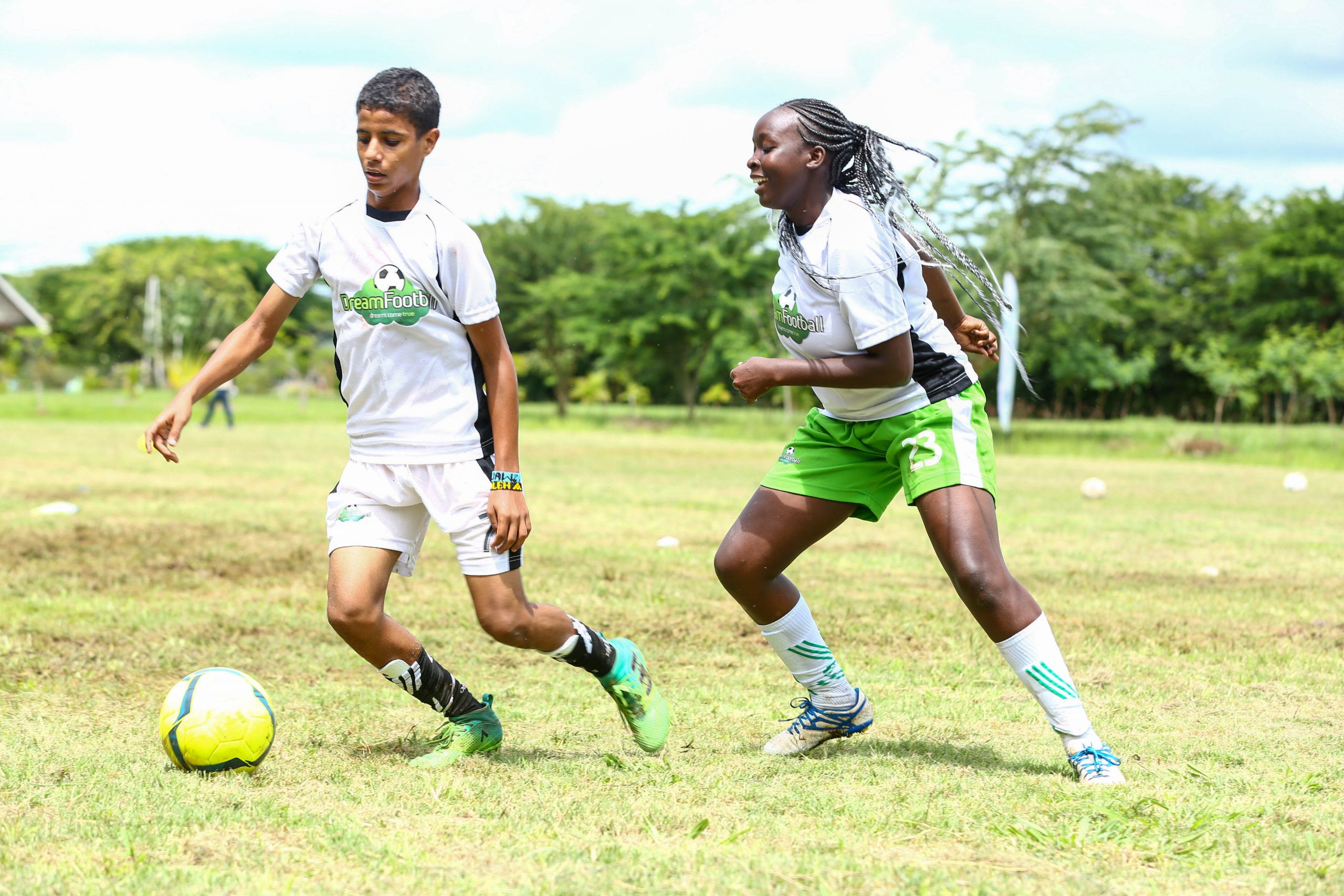 14- year- old, Swaleh Fahim, from Bahwan Muslim school (Mombasa) tackles 16- year- old, Lian Kimashia, from Maina Wanjigi Secondary School (Eastleigh) during the Dream Football Boot Camp at Ol-Donyo-Sapuk Resort. www.businesstoday.co.ke