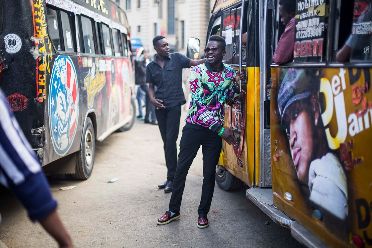 Matatu conductors at a bust stop. They are possibly among the happiest workers in Kenya. www.businesstoday.co.ke
