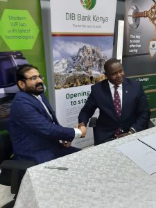 NMC Fertility centre's Atul Dureja (left) shakes hands with DIB Bank's Peter Makau after signing the partnership. www.businesstoday.co.ke