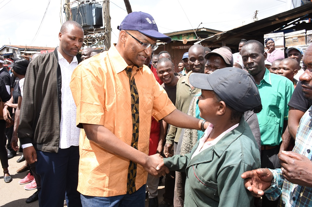 CBK Governor Dr Patrick Njoroge with traders at Gikomba market. The sector is grappling with bottlenecks that are choking its growth. www.businesstoday.co.ke