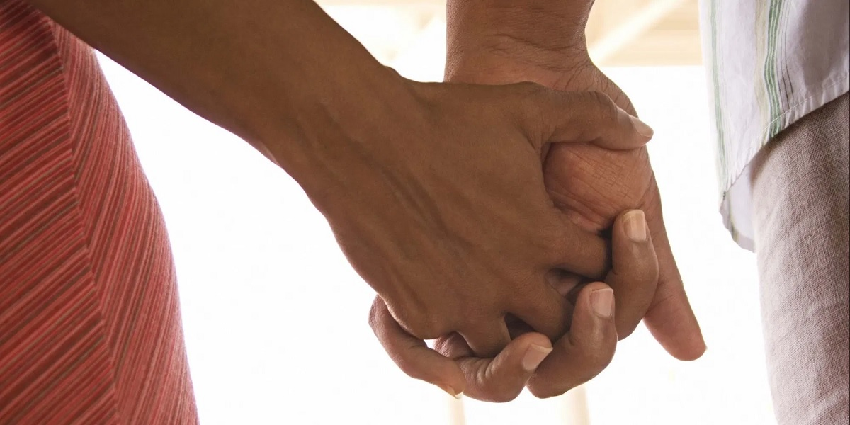 A couple holding hands. The association between sponsorship and prostitution creates shame in being associated with having a sponsor. www.businesstoday.co.ke