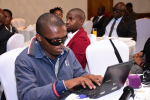 Anthony Wambua using his laptop. He has gone against all odds to learn how to code using special technology. www.businesstoday.co.ke