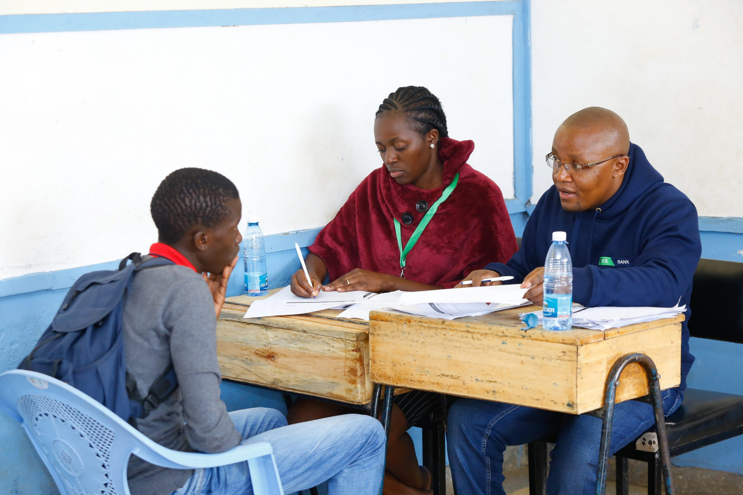 KCB Foundation Programmes Manager Stephen Matee (right) and KCB staff Velda Nasimiyu conducting an interview with one of the applicants for the KCB Scholarship Programme at Moi Avenue Primary School in Nairobi. www.businesstoday.co.ke