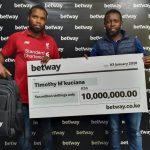 Timothy M'Kuciana receives cheque from Betway Country Manager Leon Kiptum www.businesstoday.co.ke